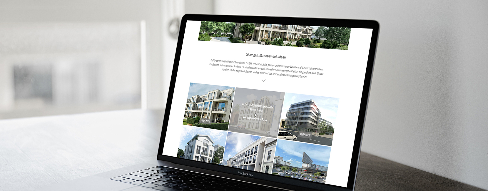 LMI Projekt Immobilien Website auf Laptop